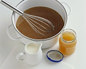 Stock in jar and pan, small jug of cream