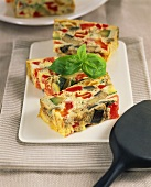 Vegetable terrine made with tomatoes, aubergines & courgettes