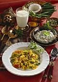 Vegetables in coconut sauce, lassi and raita (India)