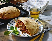 Calzone with ham and mushroom filling