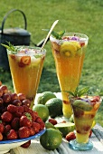 Summery fruit drink in three glasses out of doors