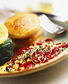 Vegetable salad with sprouted seeds and potato pancakes