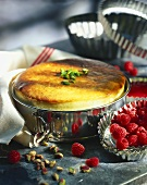Soufflé with pistachios and fresh raspberries