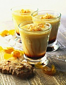 Honey coffee cream with honey sweets in glasses, biscuits