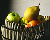 Apples and pears in stacked tart tins