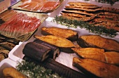 Various kinds of smoked fish on a counter
