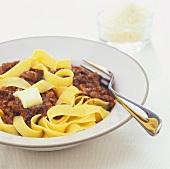 Tagliatelle alla bolognese (Tagliatelle with bolognese sauce)