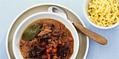 Wild boar ragout with vegetables and spaetzle noodles