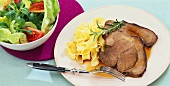 Marinated leg of wild boar with ribbon pasta and salad
