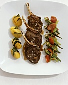 Lamb chops with bay leaf potatoes and okra pods