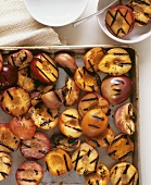 Grilled peaches in roasting tin