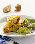 Two pieces of potato frittata with salad