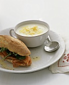 Ham baguette and a cup of cream soup