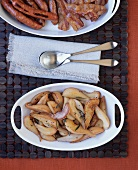 Fried apple and pear wedges (savoury accompaniment)