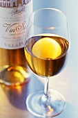 Vin Santo (Dessert wine in glass and bottle, Italy)