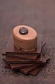 Mocca praline on squares of chocolate