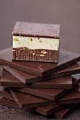Pistachio-almond praline on squares of chocolate