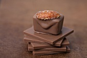 Chocolate pralines with almonds on squares of chocolate