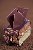 A chocolate-nut slice with chocolate flakes