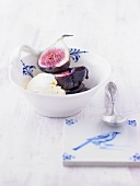 Figs with vanilla ice cream and blackberry and chocolate sauce