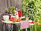 Dairy products, tomatoes and spring onions on a garden table