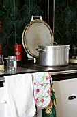 A pot on a hob in a kitchen