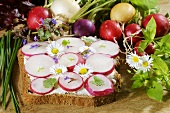 Bread with radishes and edible flowers