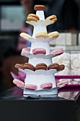 Various macarons on a cake stand