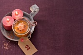 Mandarin marmalade with two candles