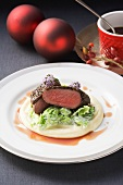 Saddle of venison with a coffee crust on creamy parsnip puree