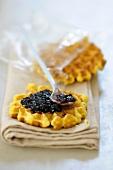 Waffles with blackberry jam