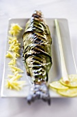 Grilled bass wrapped in banana leaves