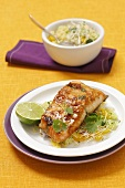 Salmon fillet with a honey glaze on a couscous and beansprout salad