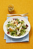 Mixed leaf salad with pears, Parmesan and a mustard dressing
