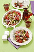 Watermelon salad with beans, feta and red onions