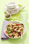 Pasta salad with chickpeas, dried tomatoes and capers