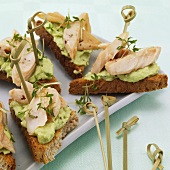 Open sandwiches with avocado cream and smoked fish