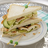 Chicken breast and cucumber sandwiches cut into triangles