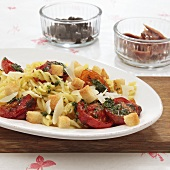 Pasta salad with herb tomatoes, Pecorino cheese and croutons