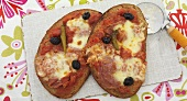 Pizza bread with salami, chillies and olives