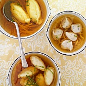 Broth with semolina dumplings, meat dumplings and ricotta dumplings