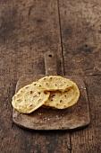 Mini cornflour tortillas on a wooden board