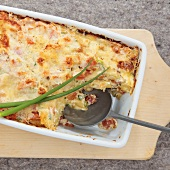 Pasta bake with tomatoes, spring onions and ricotta