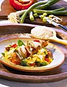 Chicken kebabs on vegetable rice