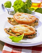 Turkey escalopes topped with tomatoes and melted cheese