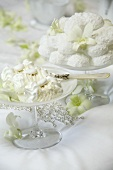 Cream dessert and baked meringues on a wedding table