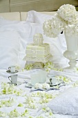 A white wedding cake and coffee cups