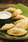 Samosas (deep-fried dough pockets filled with curried vegetables)