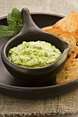 A pea dip with bread