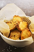 Roasted, salted potatoes in a paper-lined bowl